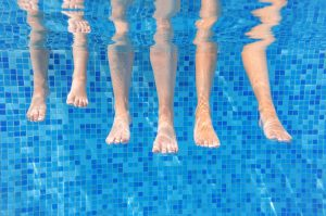 aqua shine pool services Funny underwater family legs in swimming pool