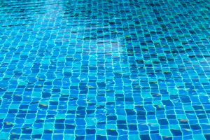 Blue pool water, ripped water in swimming pool, aqua shine pool services